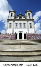 Steps leading up to colorful wall of wish ribbons at the entrance to the Igreja Nosso Senhor do Bonfim da Bahia church in Salvador Bahia Brazil
