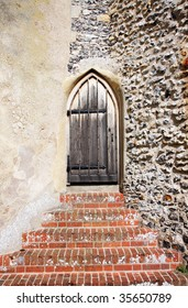 Steps leading up to a Medieval wooden Church door