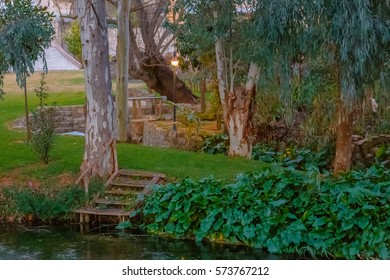 Steps leading from the river banks to a dreamy backyard of country house