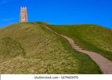 Steps leading up to the stunning Glastonbury Tor in Glastonbury, Somerset, UK.