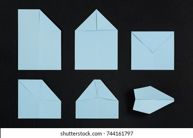 steps of making a paper plane on black