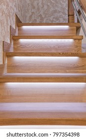 Steps of oak staircase with LED backlight