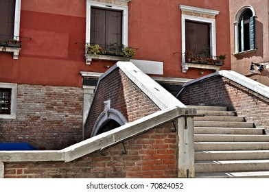 Steps on a bridge over a canal in Venice, Italy