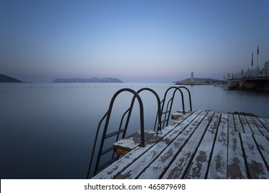 Steps to sea and swimming platform. In Kas, a resort in Turkey. In the background the Greek Island of Kastelorizo