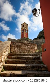 Steps of a staircase leading to a clock tower in an old fortress on an Corfu island in Greece