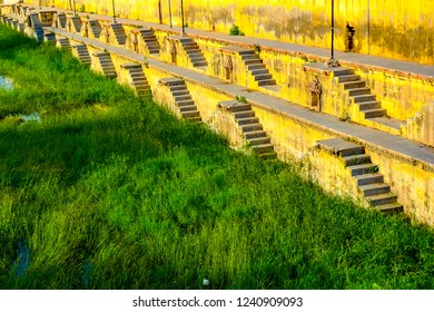 Stepwell stairs descending on watergrass in Udaipur, Rajasthan, India
