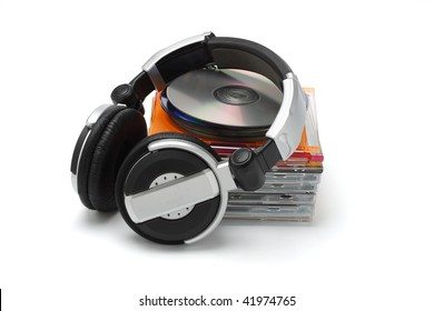 Stereo headphone and compact discs on white background