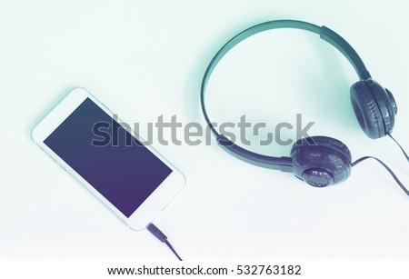 Stereo Headphones Mobile Phone Online Music Stock Photo (Edit Now