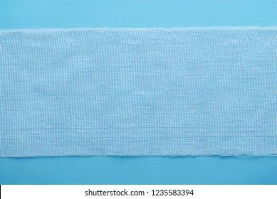 Sterile bandage on blue. Medical equipment. Sterile bandage texture.