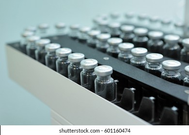 Sterile bottles and ampoules on the dispensing line.Sealed ampoules with medicine.Sterile capsules for injection. Bottles on the bottling line of the pharmaceutical plant.