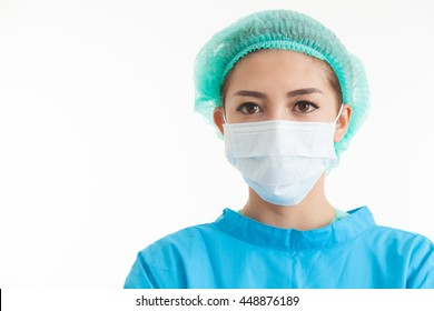 Sterile femal nurse or surgeon wearing a sterile blue suit or gown waiting on the operation theater isolated