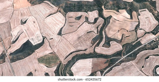 sterile,allegory, tribute to Matisse, Picasso, abstract photography of the Spain fields from the air, aerial view, representation of human labor camps, abstract, cubism,abstract naturalism