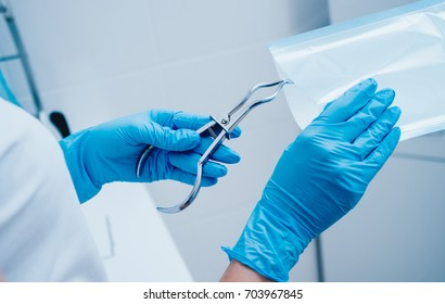 Sterilizing medical instruments in autoclave. Dental office