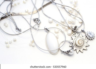 Sterling Silver jewelry on a white background, pearls