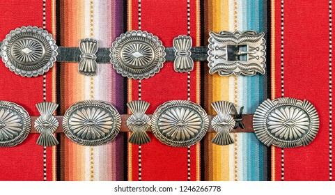 Sterling Silver Native American Concho Belt on Southwestern Pattern Fabric.