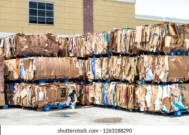 Sterling, USA - April 4, 2018: Walmart, Wal-mart trailer tractor loading dock station with stacks, piles of many stacked, compressed cardboard boxes by store, shop for recycling