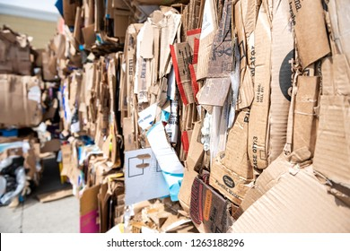 Sterling, USA - April 4, 2018: Closeup of many stacks, piles of compressed stacked cardboard boxes at truck loading dock station at Walmart, Wal-mart store, shop prepared for recycling