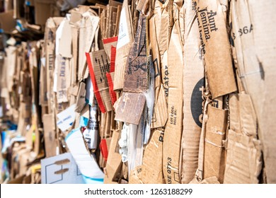 Sterling, USA - April 4, 2018: Closeup of many stacks, piles of compressed stacked cardboard boxes at truck loading dock station at Walmart, Wal-mart store, shop for recycling