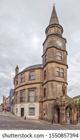 STERLNG, GREAT BRITAIN - AUGUST 24, 2019: Photo of Athenaeum building with a statue of William Wallace.