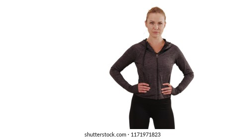 3647b38ccc9ba Stern blonde young lady on white background posing proudly with hands at  hips