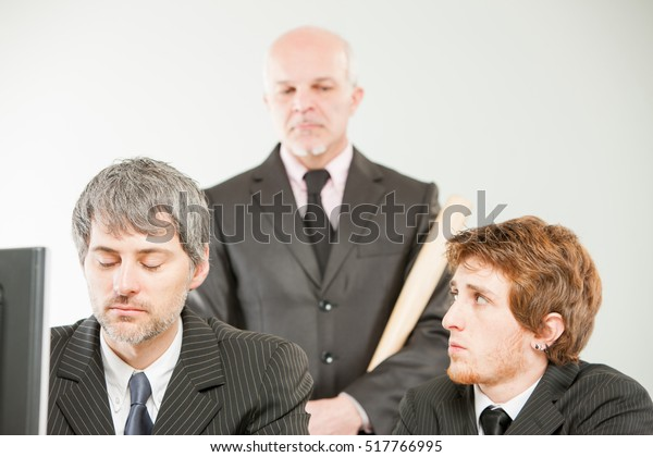 stern boss controls office workers from behind their backs ready to beat them if they fail in something