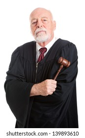 Stern judge holding his gavel, isolated on white.