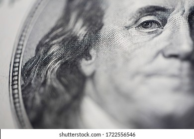stern look, close-up eyes macro, look at a 100 dollar bill, the eyes of President Franklin