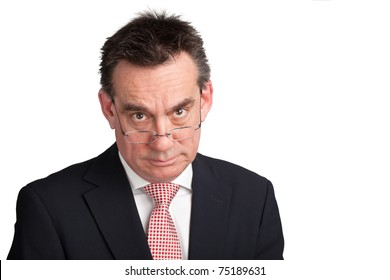 Stern Middle Age Man in Suit looking over Spectacles