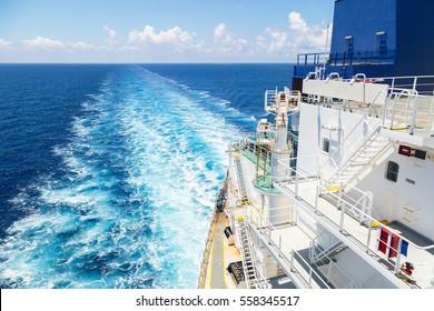 Stern of oil tanker is underway.