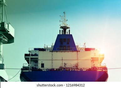 Stern of old Cargo ship under Repair in floating dry dock with scaffolding in stalled on deck in shipyard Thailand vintage tone