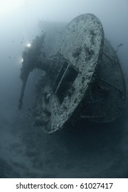 The stern section anti aircraft guns of the world war two shipwreck the SS Thistlegorm, Scuba diver in the background. Red Sea, Egypt.