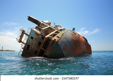 Stern of wrecked cargo ship at cape tarhankut, Crimea. The weather is clear, there are vawes at the sea.