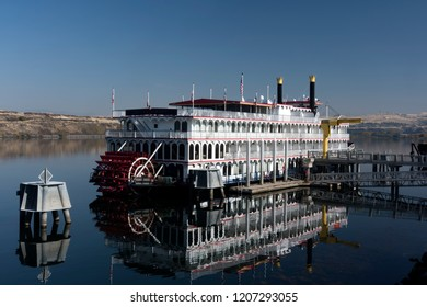 A sternwheeler docked at The Dalles, Oregonn on the Columbia River.  The water was calm, and the day was bright.