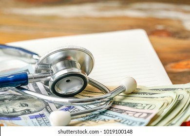 Stethoscope and banknote with healthcare concept.