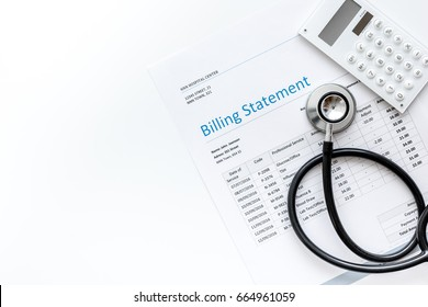 stethoscope, billing statement for doctor's work white background top view space for text