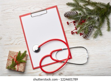 Stethoscope, blank clipboard and Christmas decorations. Medical concept. Greeting card. New Year and Christmas.