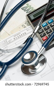 "Stethoscope, blank prescription, calculator and money (Czech koruna): health financing and corrupt practices concept. Selective focus on prescription and word ""receipt""."
