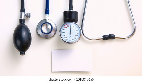 A stethoscope and blood pressure gauge on a white background