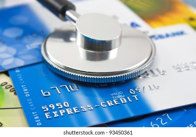 A stethoscope by a Credit cards payment