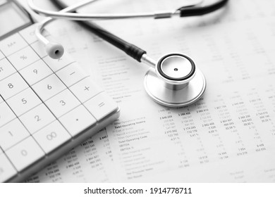 Stethoscope and calculator. Concept of health care costs or medical insurance