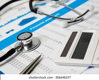 Stethoscope, calculator and financial papers