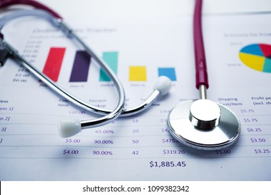 Stethoscope, Charts and Graphs paper, Finance, Account, Statistics, Investment, Analytic research data economy and Business company meeting concept.