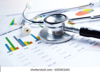 Stethoscope, Charts and Graphs paper, Saving stack coins money, globe and credit card. Finance, Account, Statistics, Investment, Analytic research data economy and Business company meeting concept.