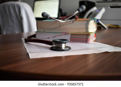 Stethoscope close-up with a doctors office in background. Medicine, health, medical, education
