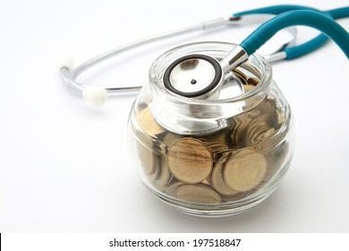 stethoscope with coins in the savings, financial concept