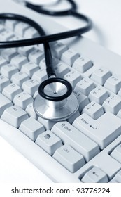 Stethoscope and Computer Keyboard, concept of Healthcare And Medicine