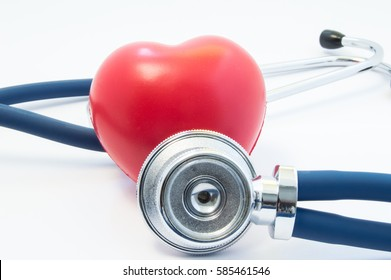 Stethoscope examines heart shape in front and twists around. Concept picture for process diagnostics, treatment and prevention of heart disease such as myocardial infarction, arrhythmia, heart failure
