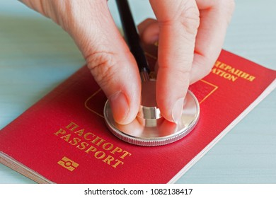 Stethoscope in the fingers on a foreign passport