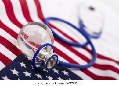 Stethoscope and globe on a USA flag
