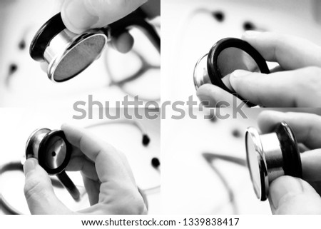 The stethoscope in hand closeup set, blurred background.